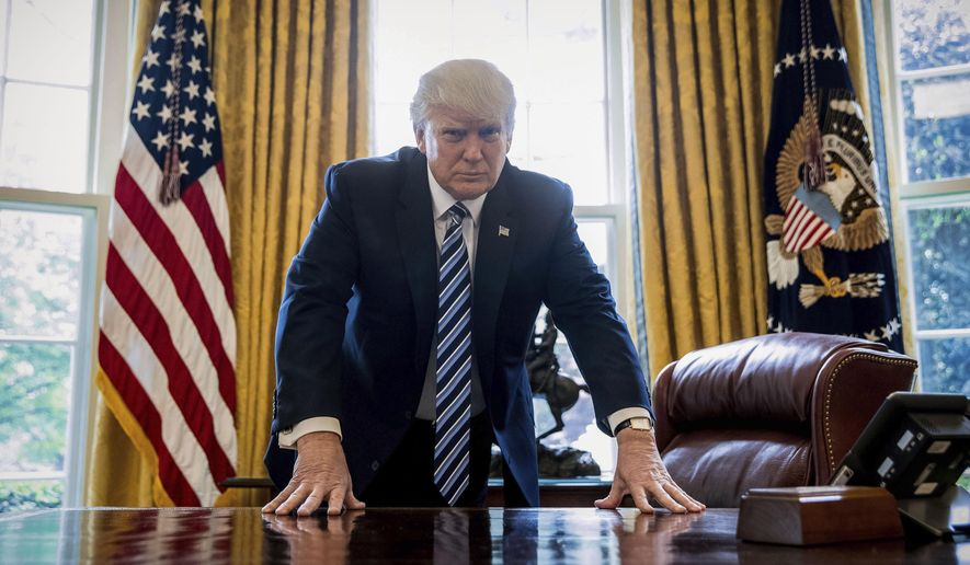 """While I favor tough measures to punish and deter aggressive and destabilizing behavior by Iran, North Korea and Russia, this legislation is significantly flawed,"" President Trump said in a signing statement to Capitol Hill. (Associated Press/File)"