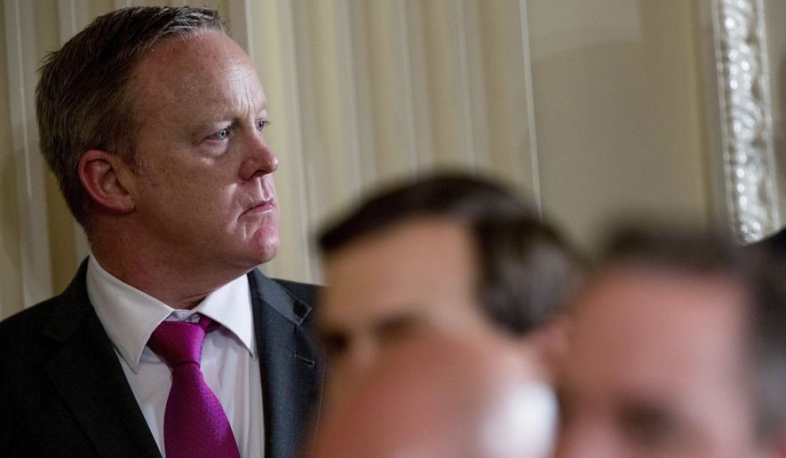 White House press secretary Sean Spicer attends a joint news conference with President Donald Trump and Colombian President Juan Manuel Santos in the East Room of the White House, Thursday, May 18, 2017, in Washington. (AP Photo/Andrew Harnik)
