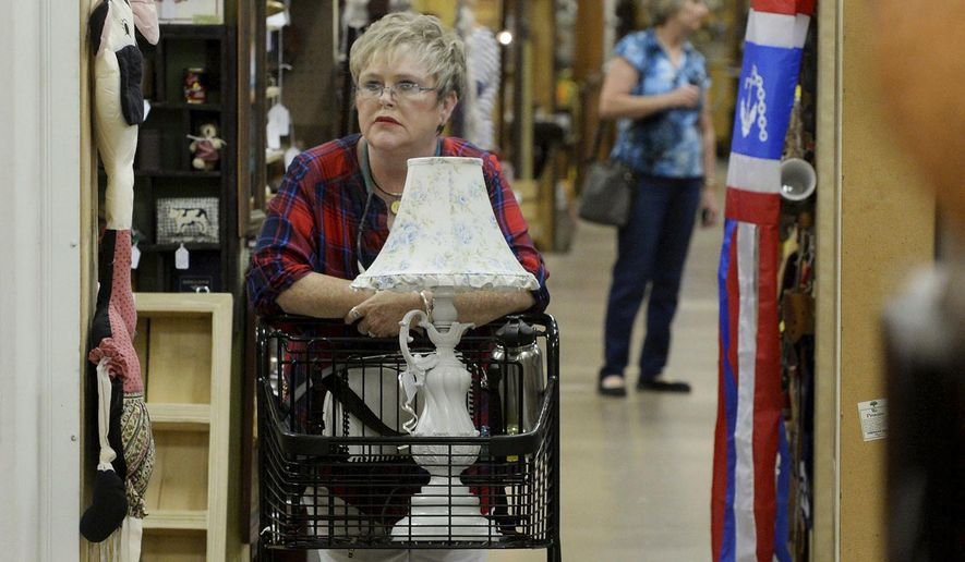 ADVANCE FOR USE SUNDAY, MAY 21, 2017 AND THEREAFTER - In this May 11, 2017 photo, Terry Abercrombie of Winter Haven shops at the Wildwood Antique Mall in Lakeland, Fla. The Mall opened last July and has about 280 vendors. (Scott Wheeler/The Ledger via AP)