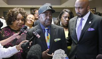 The Rev. Joey Crutcher, father of Terence Crutcher, talks with the media following the verdict in the trial of Tulsa police officer Betty Jo Shelby in Tulsa, Okla., Wednesday, May 17, 2017. Shelby was charged with manslaughter in the shooting of Terence Crutcher, an unarmed black man. Shelby was found innocent Wednesday. At left is Leanna Crutcher, the mother of Terence Crutcher and at right is Crutcher family attorney Damario Solomon-Simmons. (AP Photo/Sue Ogrocki)