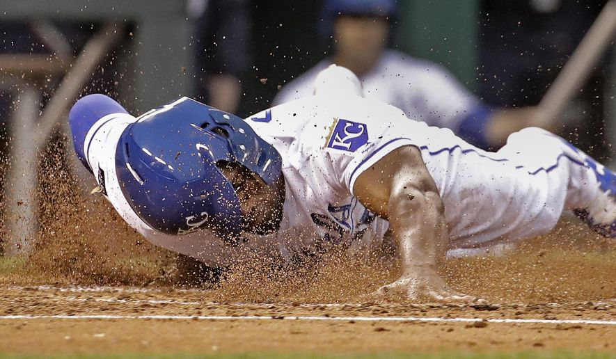 Kansas City Royals' Jorge Soler slides home to score on a single by Drew Butera during the second inning of a baseball game against the New York Yankees on Thursday, May 18, 2017, in Kansas City, Mo. (AP Photo/Charlie Riedel)