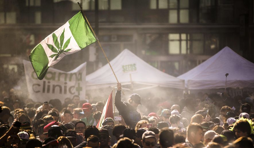 People smoke marijuana during a 4/20 cannabis culture rally in Toronto. (Mark Blinch/The Canadian Press via AP, File)