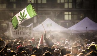 In this April 20, 2016, file photo, people smoke marijuana during a 4/20 cannabis culture rally in Toronto. (Mark Blinch/The Canadian Press via AP, File)