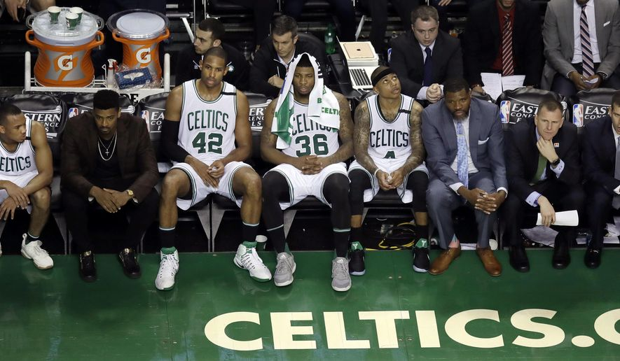 Boston Celtics players and coaches watch from the bench during the final minutes of Game 1 against the Cleveland Cavaliers during the NBA basketball Eastern Conference finals, Wednesday, May 17, 2017, in Boston. (AP Photo/Charles Krupa)