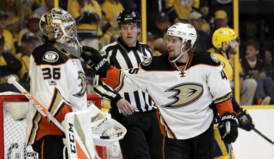 Anaheim Ducks defenseman Sami Vatanen (45), of Finland, congratulates goalie John Gibson (36), in the second period of Game 4 of the Western Conference final against the Nashville Predators, in the NHL hockey Stanley Cup playoffs Thursday, May 18, 2017, in Nashville, Tenn. (AP Photo/Mark Humphrey)