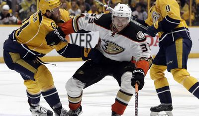 Anaheim Ducks left wing Jakob Silfverberg (33), battles for the puck between Nashville Predators left wing Filip Forsberg (9), and defenseman Mattias Ekholm, all of Sweden, in the third period of Game 4 of the Western Conference final in the NHL hockey Stanley Cup playoffs Thursday, May 18, 2017, in Nashville, Tenn. (AP Photo/Mark Humphrey)