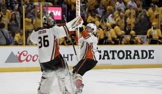 Anaheim Ducks center Andrew Cogliano celebrates with goalie John Gibson (36) after defeating the Nashville Predators in overtime of Game 4 of the Western Conference final in the NHL hockey Stanley Cup playoffs Thursday, May 18, 2017, in Nashville, Tenn. The Ducks won 3-2. (AP Photo/Mark Humphrey)