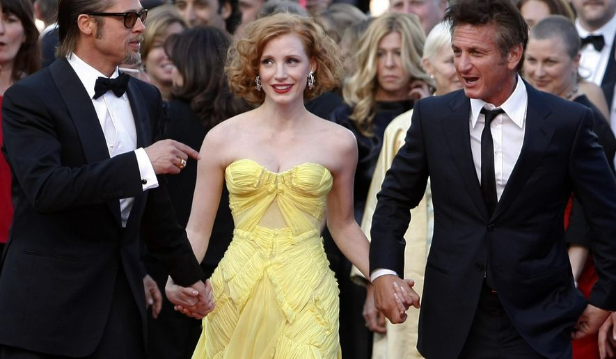 "FILE - In this May 16, 2011 file photo, actors Brad Pitt,  from left, Jessica Chastain and Sean Penn arrive for the screening of their film, ""The Tree of Life,"" by filmmaker Terrence Malick, at the 64th international film festival, in Cannes, southern France. The film, which won the Palme d'Or award, was booed by critics at the film screening.  (AP Photo/Lionel Cironneau, File)"