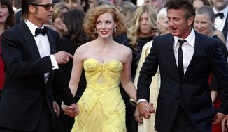 """FILE - In this May 16, 2011 file photo, actors Brad Pitt,  from left, Jessica Chastain and Sean Penn arrive for the screening of their film, """"The Tree of Life,"""" by filmmaker Terrence Malick, at the 64th international film festival, in Cannes, southern France. The film, which won the Palme d'Or award, was booed by critics at the film screening.  (AP Photo/Lionel Cironneau, File)"""