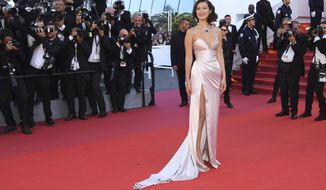 Model Bella Hadid poses for photographers upon arrival at the opening ceremony and the screening of the film Ismael's Ghosts at the 70th international film festival, Cannes, southern France, Wednesday, May 17, 2017. (Photo by Arthur Mola/Invision/AP)
