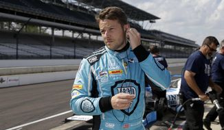 Marco Andretti prepares to drive during a practice session for the Indianapolis 500 IndyCar auto race at Indianapolis Motor Speedway, Thursday, May 18, 2017 in Indianapolis. (AP Photo/Michael Conroy)