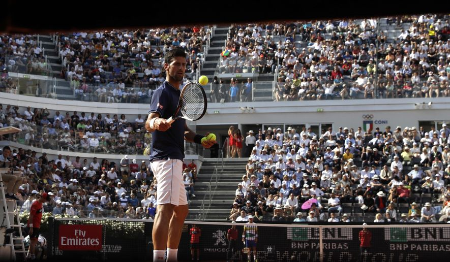 Serbia's Novak Djokovic during his match against Spain's Roberto Bautista Agut at the Italian Open tennis tournament, in Rome, Thursday, May 18, 2017. (AP Photo/Alessandra Tarantino)