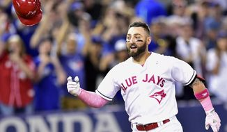 Toronto Blue Jays outfielder Kevin Pillar (11) celebrates his game winning home run against the Seattle Mariners during ninth inning American League baseball action in Toronto, Sunday, May 14, 2017. (Frank Gunn/The Canadian Press via AP)