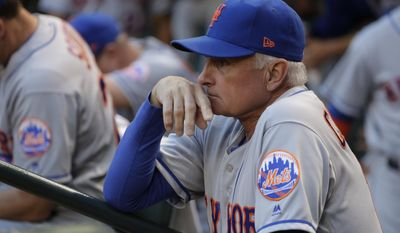 FILE - In this May 15, 2017, file photop, New York Mets manager Terry Collins watches during the first inning of the team's baseball game against the Arizona Diamondbacks in Phoenix. By the end of this week, Collins will be the longest-tenured manager in Mets history. Hard to believe, really. Then again, nothing is ever easy for Collins and the Mets. With his team on a seven-game losing streak 6 1/2 weeks into a trying season, Collins is set to catch Davey Johnson on Friday night for most games managed in a Mets uniform (1,012).(AP Photo/Matt York, File)