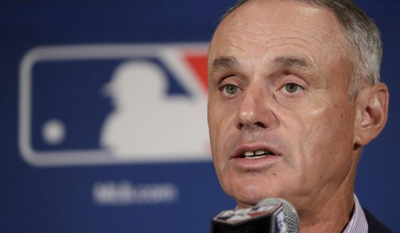 "FILE - In this Feb. 21, 2017, file photo, Major League Baseball Commissioner Rob Manfred answers questions at a news conference in Phoenix. Baseball fans can like their team's games with a click starting Friday. Major League Baseball announced Facebook will carry a live game nationally each Friday starting with Colorado at Cincinnati this week. The Facebook package of 20 games will use the broadcast feed of one of the involved teams. Baseball Commissioner Rob Manfred made the announcement Thursday, May 18, 2017. He calls it ""really important for us in terms of experimenting with a new partner in this area.""(AP Photo/Morry Gash, File)"