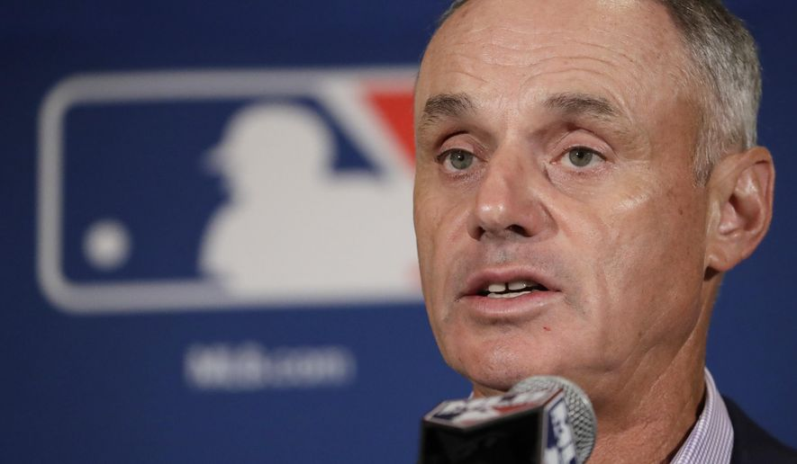 FILE - In this Feb. 21, 2017, file photo, Major League Baseball Commissioner Rob Manfred answers questions at a news conference in Phoenix. On March 9, 2018, MLB announced a deal with Facebook to stream 25 afternoon games in the 2018 season. (AP Photo/Morry Gash, File)