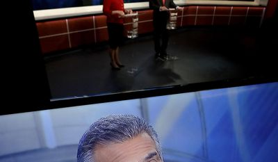 New Jersey Assemblyman Jack Ciattarelli, top right, is seen on a television monitor as speaks during a Republican gubernatorial primary debate against Lt. Gov. Kim Guadagno, Thursday, May 18, 2017, in Newark, N.J. (AP Photo/Julio Cortez, Pool)