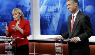New Jersey Lt. Gov. Kim Guadagno, left, speaks as Assemblyman Jack Ciattarelli reacts during a Republican gubernatorial primary debate, Thursday, May 18, 2017, in Newark, N.J. (AP Photo/Julio Cortez, Pool)