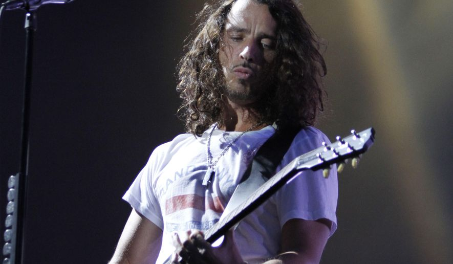 FILE - In this Sunday, Aug. 8, 2010, file photo, musician Chris Cornell of Soundgarden performs during the Lollapalooza music festival in Grant Park in Chicago. According to his representative, rocker Chris Cornell, who gained fame as the lead singer of Soundgarden and later Audioslave, has died Wednesday night in Detroit at age 52. (AP Photo/Nam Y. Huh, File)