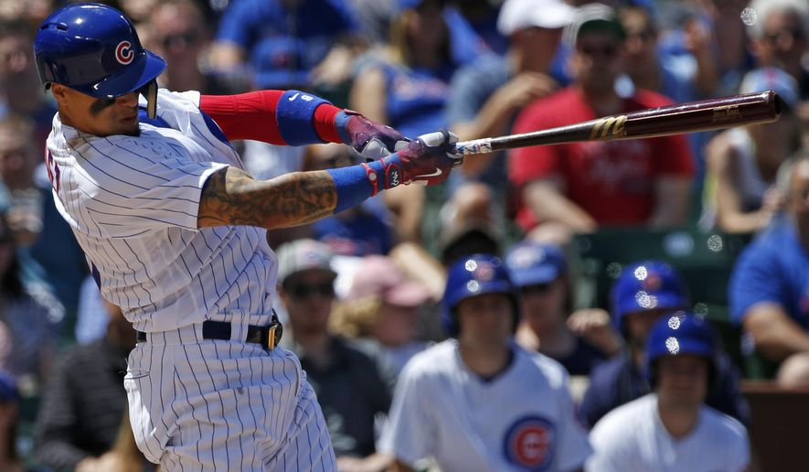 Chicago Cubs' Javier Baez hits a grand slam during the first inning of a baseball game against the Cincinnati Reds in Chicago, Thursday, May 18, 2017. (AP Photo/Nam Y. Huh)