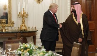 FILE -- In this March 14, 2017, file photo, President Donald Trump shakes hands with Saudi Defense Minister and Deputy Crown Prince Mohammed bin Salman, in the State Dining Room of the White House in Washington. Saudi Arabia is making every effort to dazzle and impress President Donald Trump on his first overseas trip. The kingdom wants to seize on the historic visit to cement itself as a major player on the world stage and shove aside rival Iran as a rogue state on the fringes of the Muslim world. (AP Photo/Evan Vucci, File)