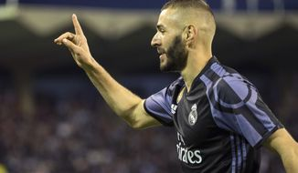 Real Madrid's Karim Benzema celebrates after scoring the third goal against Celta during a Spanish La Liga soccer match between Celta and Real Madrid at the Balaidos stadium in Vigo, Spain, Wednesday, May 17, 2017. (AP Photo/Lalo R. Villar)