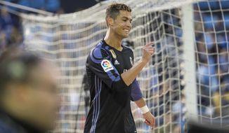 Real Madrid's Cristiano Ronaldo gestures during a Spanish La Liga soccer match between Celta and Real Madrid at the Balaidos stadium in Vigo, northern Spain, Wednesday, May 17, 2017. (AP Photo/Lalo R. Villar)