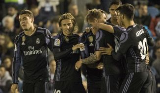 Real Madrid's Toni Kroos, center right, is congratulated by teammates after scoring their fourth goal during a Spanish La Liga soccer match between Celta and Real Madrid at the Balaidos stadium in Vigo, Spain, Wednesday, May 17, 2017. (AP Photo/Lalo R. Villar)