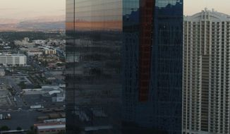 FILE--In this Oct. 20, 2009, file photo, Planet Hollywood property PH Towers Westgate is pictured near the Las Vegas Strip in Las Vegas. A tourist has filed a lawsuit against the Planet Hollywood casino-hotel on the Las Vegas Strip, claiming he was seriously injured while trying to escape his room because he was scared of a life-sized mannequin. (AP Photo/Isaac Brekken, file)
