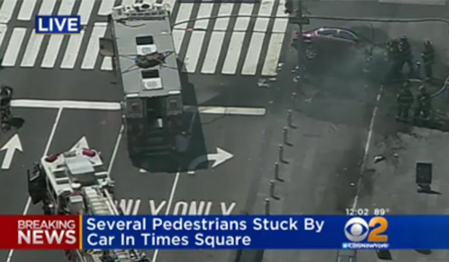 Several pedestrians were struck by a car in New York's Times Square Thursday. (CBS2)