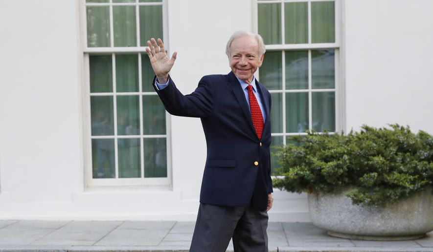 Former Connecticut Sen. Joe Lieberman waves to members of the media as he leaves the West Wing of the White House in Washington, Wednesday, May 17, 2017. (AP Photo/Pablo Martinez Monsivais) ** FILE **