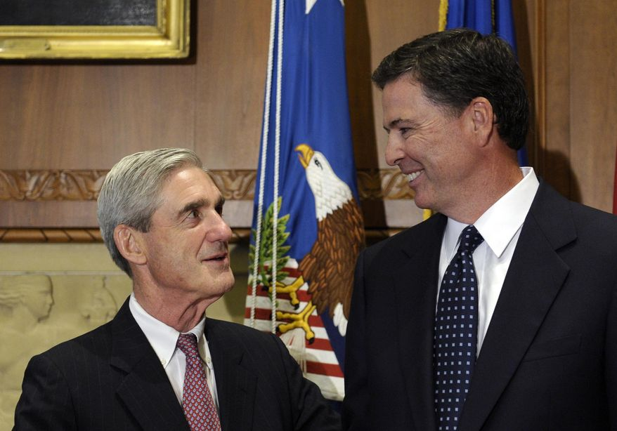 In this Sept. 4, 2013, file photo, then-incoming FBI Director James Comey talks with outgoing FBI Director Robert Mueller before Comey was officially sworn in at the Justice Department in Washington.  On May 17, 2017, the Justice Department said it is appointing Mueller as special counsel to oversee investigation into Russian interference in the 2016 presidential election. (AP Photo/Susan Walsh, File) **FILE**