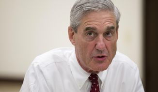 FILE - In this Aug. 21, 2013, file photo, then-FBI director Robert Mueller speaks during an interview at FBI headquarters in Washington. The Justice Department on May 17, 2017, appointed Mueller as a special counsel to oversee a federal investigation into potential coordination between Russia and the Trump campaign during the 2016 presidential election. (AP Photo/Evan Vucci, File)