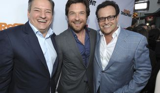 "FILE - In this April 29, 2013, file photo, Ted Sarandos, Jason Bateman, and Mitchell Hurwitz attend the season four premiere of ""Arrested Development"" at the TCL Chinese Theatre in Los Angeles. Netflix announced on May 17, 2017, that the series would return for a fifth season in 2018. (Photo by John Shearer/Invision/AP, File)"