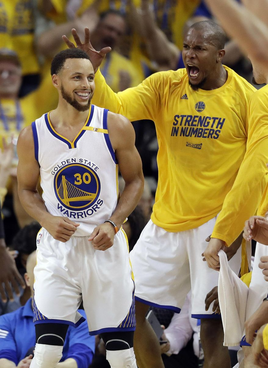 FILE - In this May 4, 2017, file photo, Golden State Warriors' Stephen Curry, left, celebrates with teammate David West after a score during the second half in Game 2 of an NBA basketball second-round playoff series against the Utah Jazz in Oakland, Calif. For all the years West yearned to be on the San Antonio Spurs, he finally got that chance last season. Now, he is facing them from the other side with the star-studded Golden State Warriors as they chase a championship, and even his old coach Gregg Popovich believes West has found a perfect fit in the Bay Area alongside Stephen Curry, Kevin Durant and all the others. (AP Photo/Marcio Jose Sanchez, File)