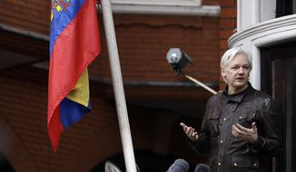 WikiLeaks founder Julian Assange gestures as he speaks on the balcony of the Ecuadorian embassy, in London, Friday May 19, 2017. (AP Photo/Matt Dunham)