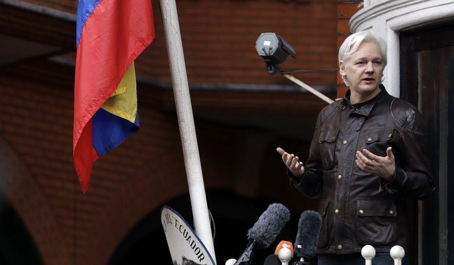 WikiLeaks founder Julian Assange gestures as he speaks on the balcony of the Ecuadorian embassy, in London, Friday May 19, 2017. (AP Photo/Matt Dunham)