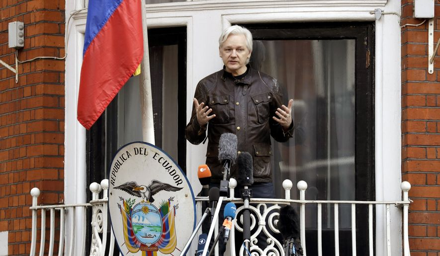 WikiLeaks founder Julian Assange gestures as he speaks on the balcony of the Ecuadorian embassy, in London, Friday May 19, 2017. Assange has won his battle against extradition to Sweden, which wanted to question him about a rape allegation. He has spent nearly five years inside the Embassy of Ecuador in London to avoid being sent to Sweden, which announced Friday that the investigation has been discontinued. (AP Photo/Matt Dunham)