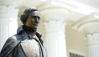 In this Aug. 25, 2016, file photo, a a statue of Confederate President Jefferson Davis sits the grounds of the Alabama Capitol in Montgomery, Ala. (AP Photo/Jay Reeves, File)