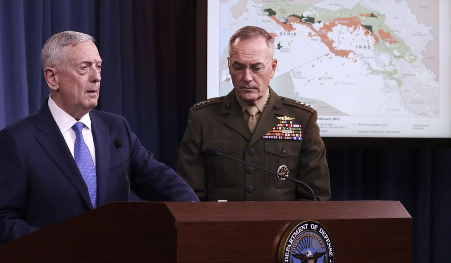 Defense Secretary Jim Mattis and Joint Chiefs Chairman Gen. Joseph Dunford Jr., participate in a news conference at the Pentagon, Friday, May 19, 2017, to give an update on the Islamic State group. The U.S. is looking ahead toward a decisive battleground in its bid to destroy the Islamic State group, even as U.S.-backed local forces must still finish the fight for the extremists' two main strongholds in Iraq and Syria.  (AP Photo/Jacquelyn Martin)