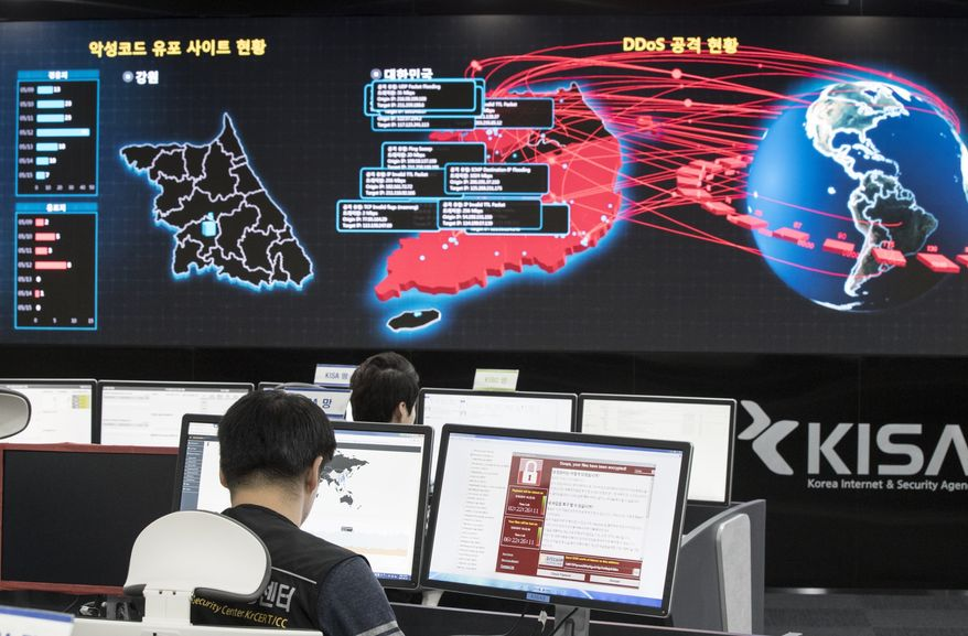 In this Monday, May 15, 2017, file photo, employees watch electronic boards to monitor possible ransomware cyberattacks at the Korea Internet and Security Agency in Seoul, South Korea. (Yun Dong-jin/Yonhap via AP, File)