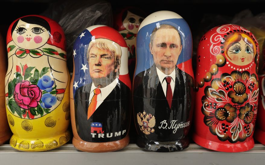 In this Monday, Feb. 20, 2017 photo, traditional Russian nesting dolls depicting US President Donald Trump, center left, and Russian President Vladimir Putin are displayed for sale at a souvenir street shop in St.Petersburg, Russia. While their country has become a daily source of headlines and political intrigue in the United States, most Russians are watching the drama over President Donald Trump's relationship with Moscow with resignation, even indifference. Russian media, state-owned and private, chronicle Mr. Trump's troubles matter-of-factly. Regular citizens generally care little about them. Many share the view that what's unfolded in Washington has dimmed prospects for the mended Russia-U.S. ties his candidacy represented here and thus have lost interest. (AP Photo/Dmitri Lovetsky, file)