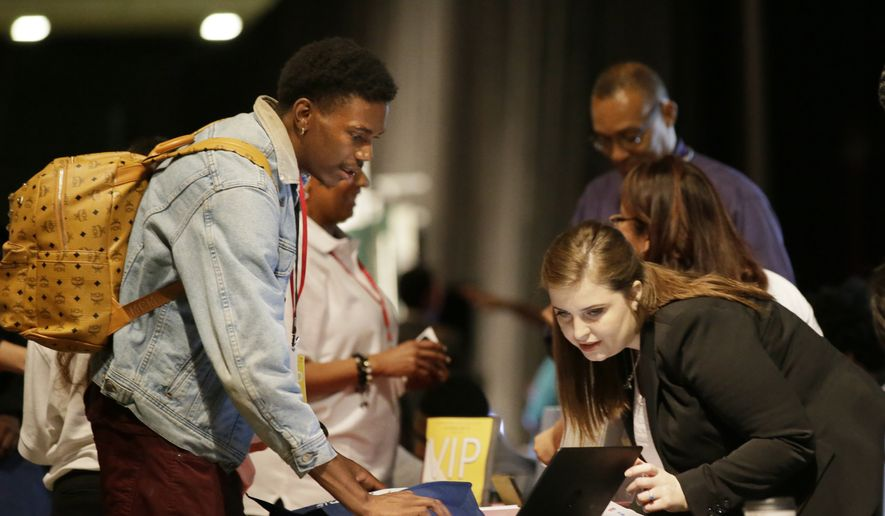 Job seeker Dalvin Jones, 22, left, chats with Valmira Haxhimusa during the Opportunity Fair and Forum employment event in Dallas, Friday, May 19, 2017. (AP Photo/LM Otero) ** FILE **