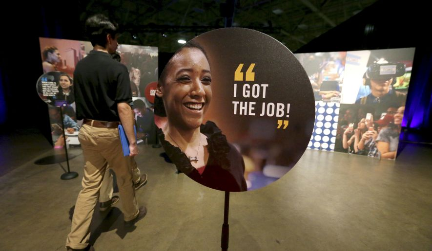 Job seekers walk into the Opportunity Fair and Forum employment event in Dallas, Friday, May 19, 2017. (AP Photo/LM Otero) ** FILE **