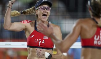 FILE - In this Aug. 15, 2016, file photo, United States' Kerri Walsh Jennings, left, and April Ross, right, celebrate winning a point during a women's beach volleyball quarterfinal match against Australia, at the 2016 Summer Olympics in Rio de Janeiro, Brazil. Beach volleyball has a new ally as it tries to grow from an Olympic phenomenon to an every-year attraction: ESPN. The sports network will broadcast the World Series of Beach Volleyball, an international pro tour stop in California in July. Event organizers hope the exposure will help beach volleyball attract new fans and hold onto the ones who watch during the Summer Games only to drift away until the next Olympics. (AP Photo/Petr David Josek, File)