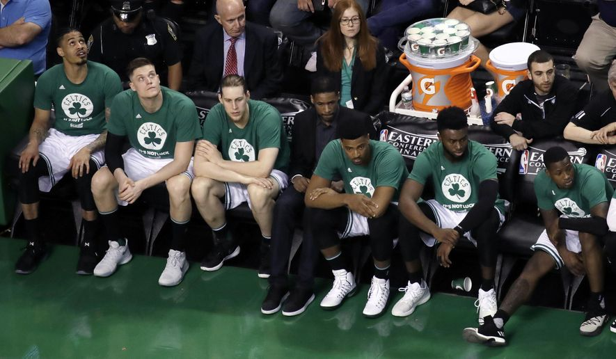 Players on the Boston Celtics bench watch play during the second half of Game 2 of the NBA basketball Eastern Conference finals against the Cleveland Cavaliers, Friday, May 19, 2017, in Boston. (AP Photo/Elise Amendola)