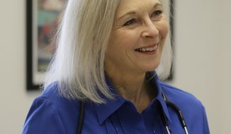 FILE-In this March 14, 2017, file photo, Utah democratic U.S. House candidate Dr. Kathryn Allen speaks during an interview at a clinic in Salt Lake City. A doctor, lawyer and handful of elected officials are among the many Republican and Democratic candidates who have announced they're jumping in the race for Rep. Jason Chaffetz's seat. At least two democrats, including Allen, have also jumped in. (AP Photo/Rick Bowmer, file)