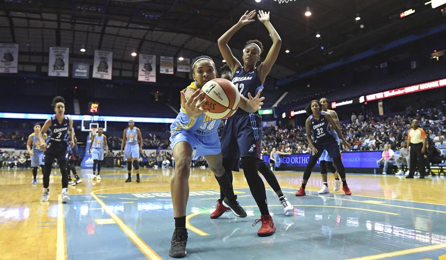Chicago Sky center Imani Boyette reaches for the ball before going out of bounds while defended by Atlanta Dream forward Damiris Dantas (12) during the first half of a WNBA basketball game Friday, May 19, 2017, in Rosemont, Ill. (Patrick Gorski/Chicago Tribune via AP)