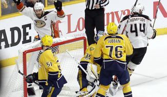 Anaheim Ducks' Ryan Getzlaf (15) and Nate Thompson (44) celebrate after the winning goal got past Nashville Predators goalie Pekka Rinne (35), of Finland, during overtime in Game 4 of the Western Conference final in the NHL hockey Stanley Cup playoffs Thursday, May 18, 2017, in Nashville, Tenn. The Ducks won 3-2 to even the series 2-2. (AP Photo/Mark Humphrey)