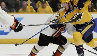 Anaheim Ducks defenseman Kevin Bieksa (2) battles against Nashville Predators center Ryan Johansen,foreground, in the second period of Game 4 of the Western Conference final in the NHL hockey Stanley Cup playoffs Thursday, May 18, 2017, in Nashville, Tenn. (AP Photo/Mark Humphrey)